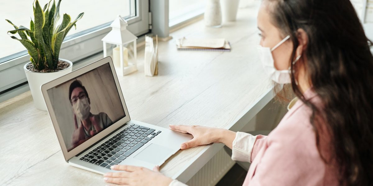 Person on video call wearing a face mask